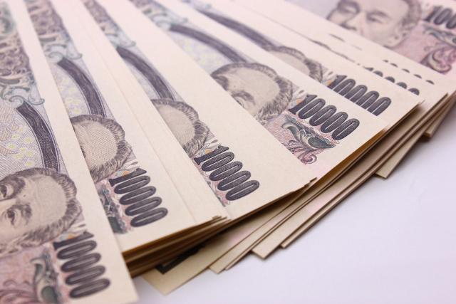 並べた10000円札